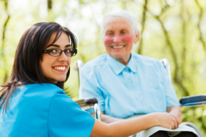 caregiver smiling and elderly woman