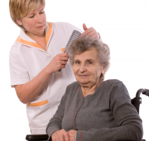 caregiver combing patient's hair