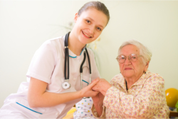 caregiver and her old woman patient