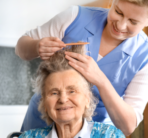 nurse combing patient's hair