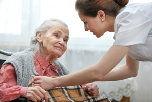 female nurse taking care of a senior woman